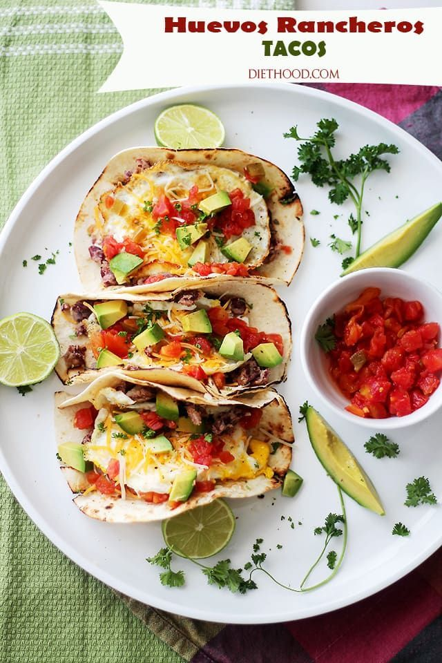 Taco Recipes Huevos Rancheros Tacos - Soft tortillas stuffed with homemade refried beans, eggs, green chilies, tomatoes, cheese and diced avocados.Huevos Rancheros Tacos - Soft tortillas stuffed with homemade refried beans, eggs, green chilies, tomatoes, cheese and diced avocados.