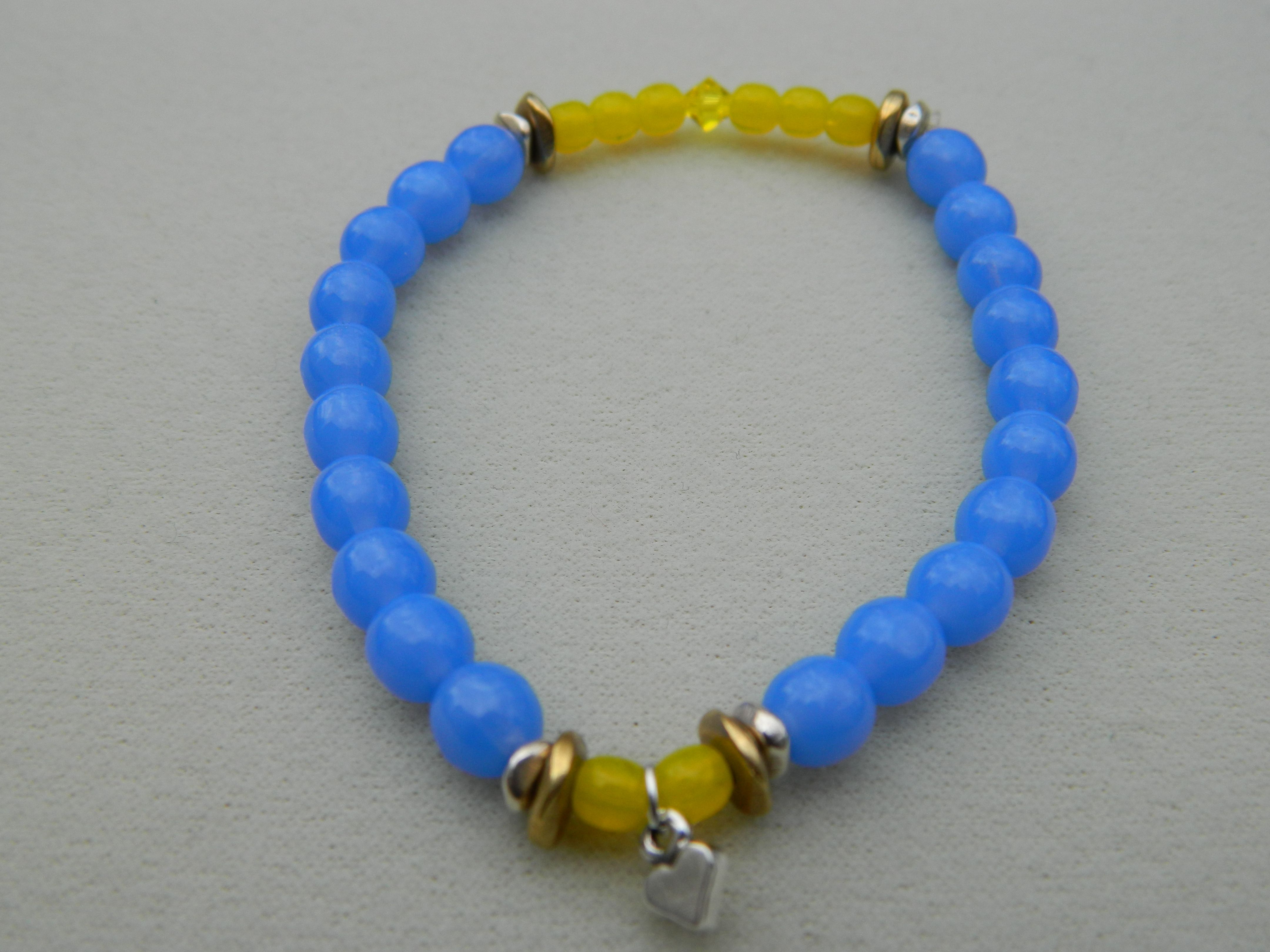 The 4.15.13 bracelet honors the injured people from the Boston Marathon. 70% of the sale of each bracelet is being donated to  http://www.gofundme.com/ChristianCarolineFund Christian and Caroline were at the finish line and injured.  Round blue and yellow Czech beads strung on elastic with sterling heart charm and brass spacer beads. www.boogsbracelets.net