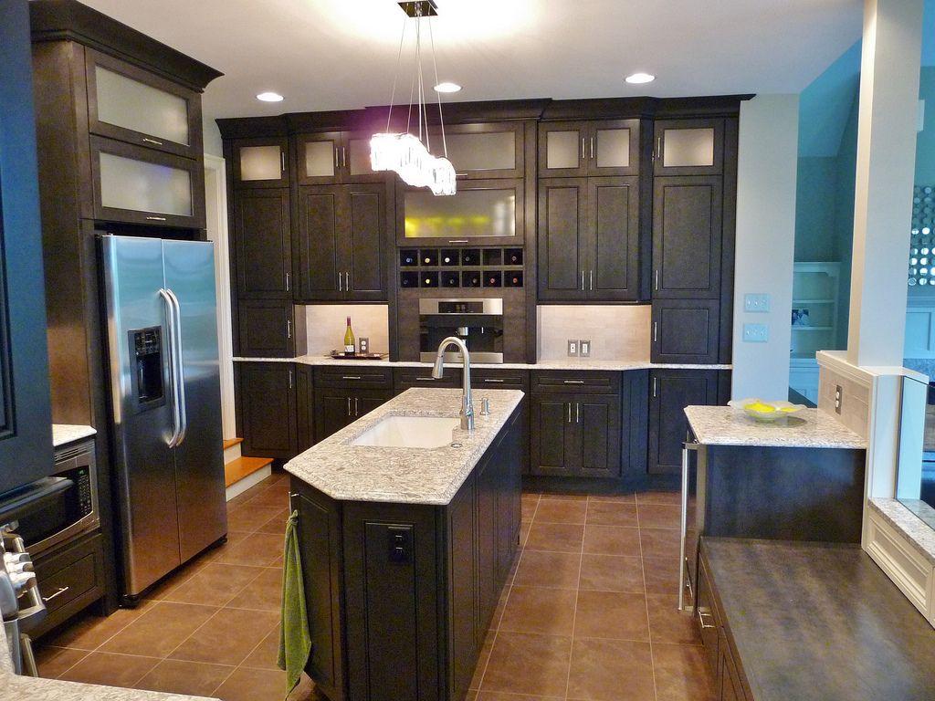 kitchen remodel, wine rack, island, tile floor, tile back splash, crystal chandelier, built in bench
