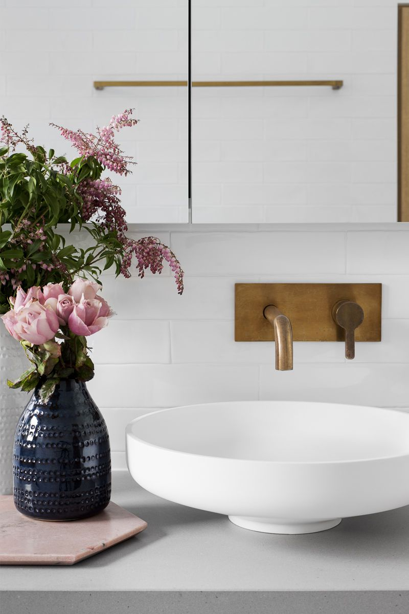 Brass faucet with white sink Gray Subway