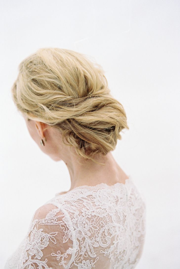 A simple updo beautifully shows off the details on the back of your