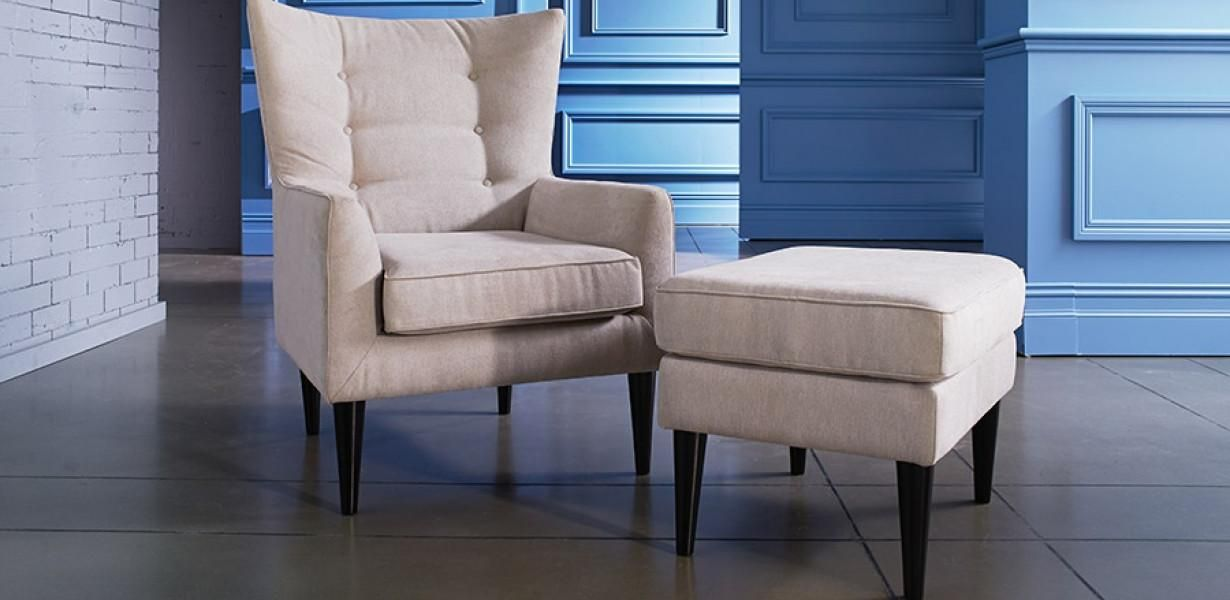 High Back Fabric Armchair With A Timber Frame. Matching Ottoman Also  Available.