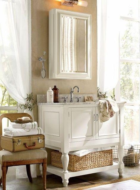 Framed White Medicine Cabinet Over Bathroom Sink Light