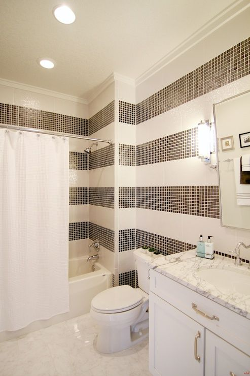 Simple Black and white bathroom features walls clad in black and white tiles creating the illusion of horizontal stripes framing rectangular pivot mirror over HD - Popular steps to tile a shower Simple Elegant