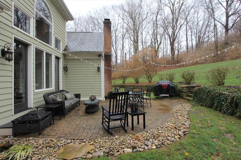 river rock patio backyard