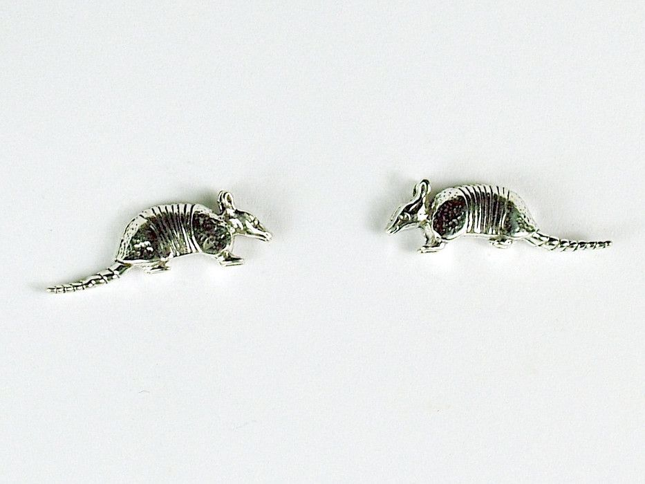 Sterling Silver and Surgical Steel armadillo stud earrings-armadillos- animal This is a fun pair of sterling silver and surgical steel armadillo stud earrings. These measure approx. 1/4 inch from top