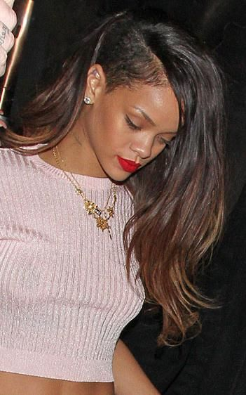 Highlights for black hair - Rihanna's latest two colored, long side-shaved hairstyle looks edgy and catchy.
