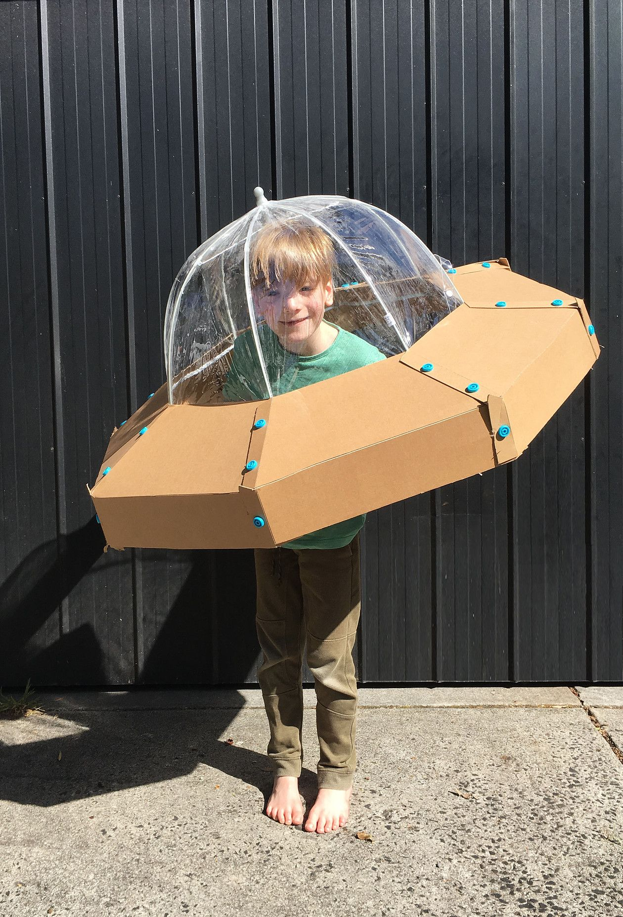 8f8b6572e9f05 A quick and easy DIY spaceship costume for kids. Made with only cardboard