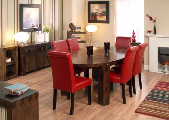 Wall color with red chairs and dark table