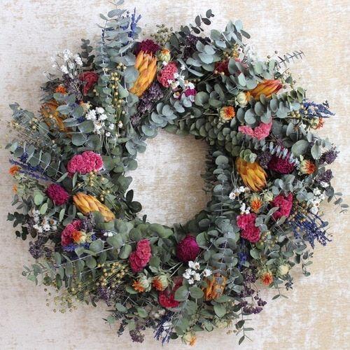 Photo of Magnolia Wreath 24″