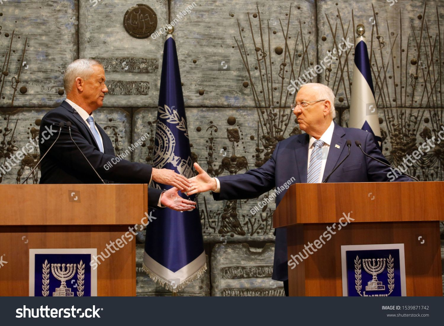 Israeli President Reuven Rivlin R presents Blue and White party leader Benny Gantz with the mandate to form a new Israeli government at the Presidents residence in Jerusa...