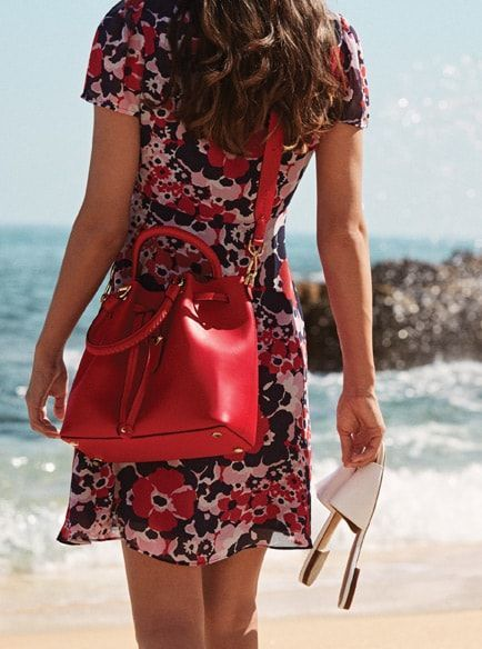 fee699ad4054 BUCKET LIST . . . Meet Blakely by Michael Michael Kors In punchy shades,  it's the bucket bag that goes everywhere.The Blakely bucket bag is crafted  from ...