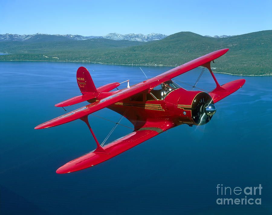 Beechcraft Model 17 Staggerwing Flying Photograph by Phil Wallick