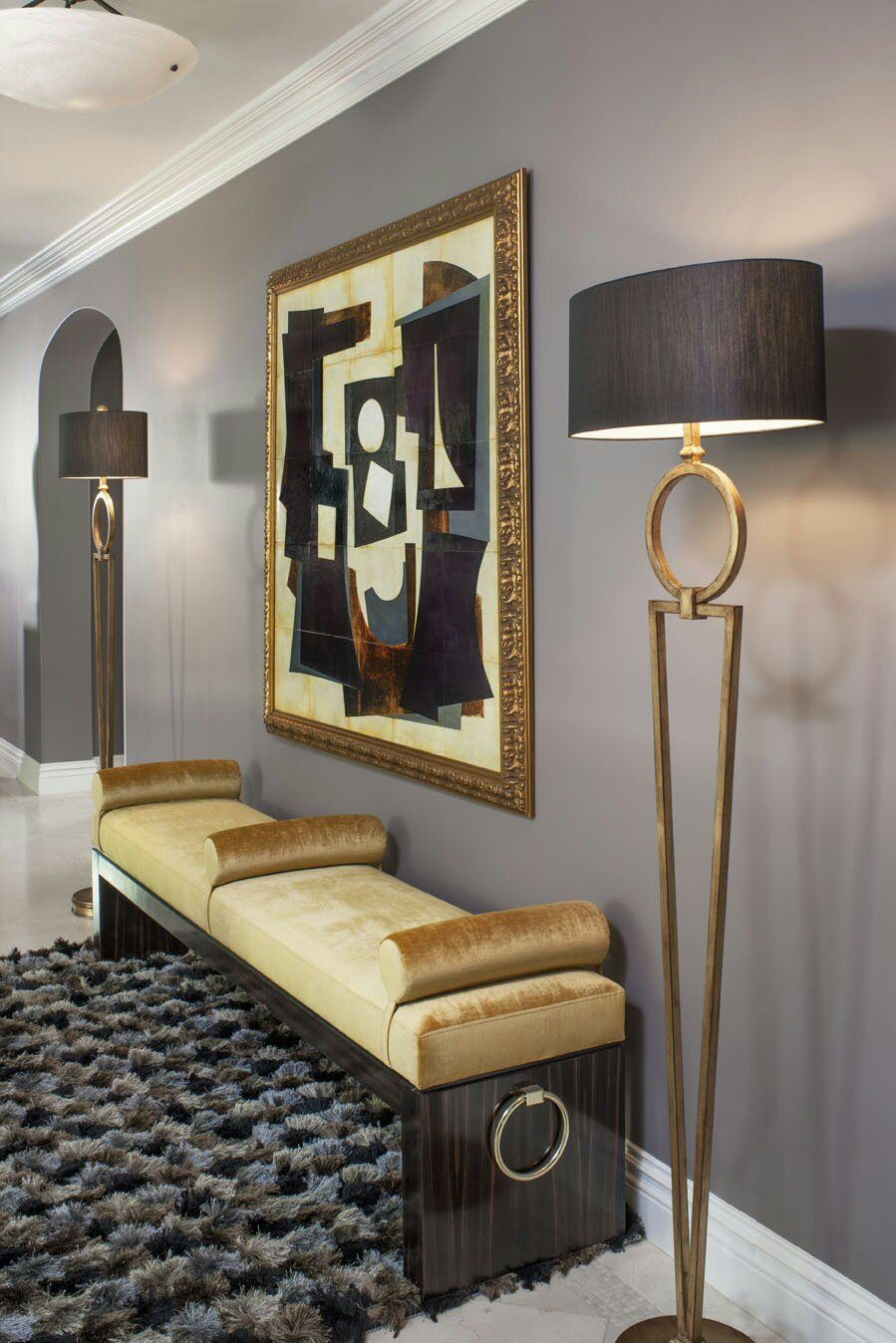 Entryfoyer soft dove gray with gold overtones stylized in a