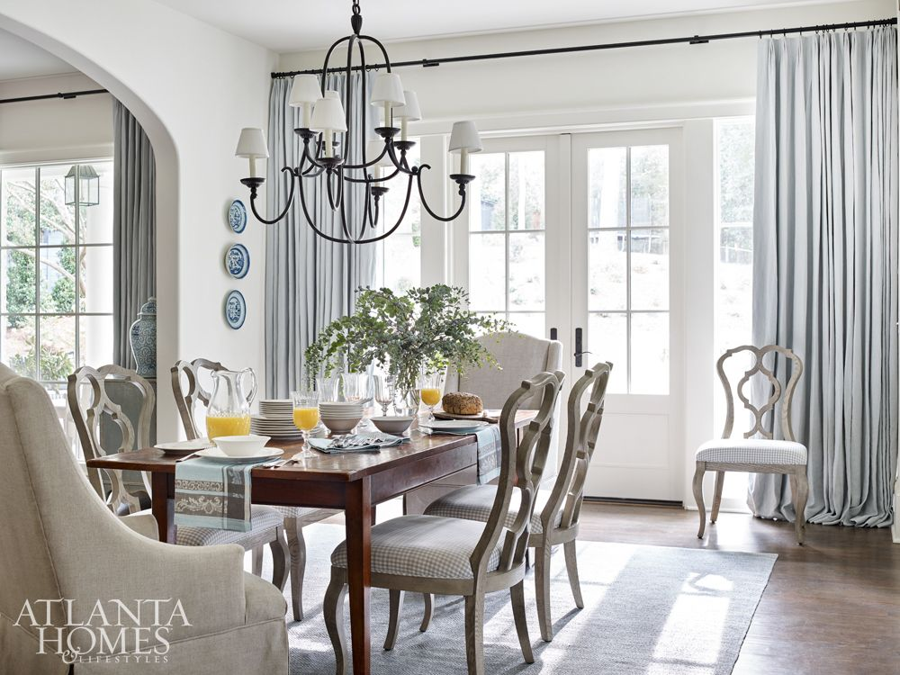 The Breakfast Room Is Softened With Sinuous Chairs With A
