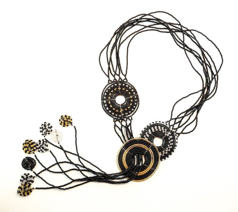 Olndende features 3 circles of life in stunning palettes with miniature circles of life at the bottom of each beaded strand - nicknamed the Princess Caroline necklace after her selection of this piece in black, gold and crystal. Phenomenal piece of wearable art!