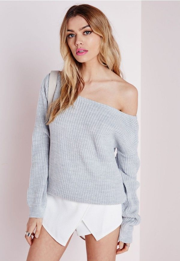 Throw over this super cool off the shoulder jumper this season. This quirky piece will add a layer of warmth to any outfit in your wardrobe. Looks super cute teamed with a wet look skinny's ankle cuff heels and a slouchy clutch.