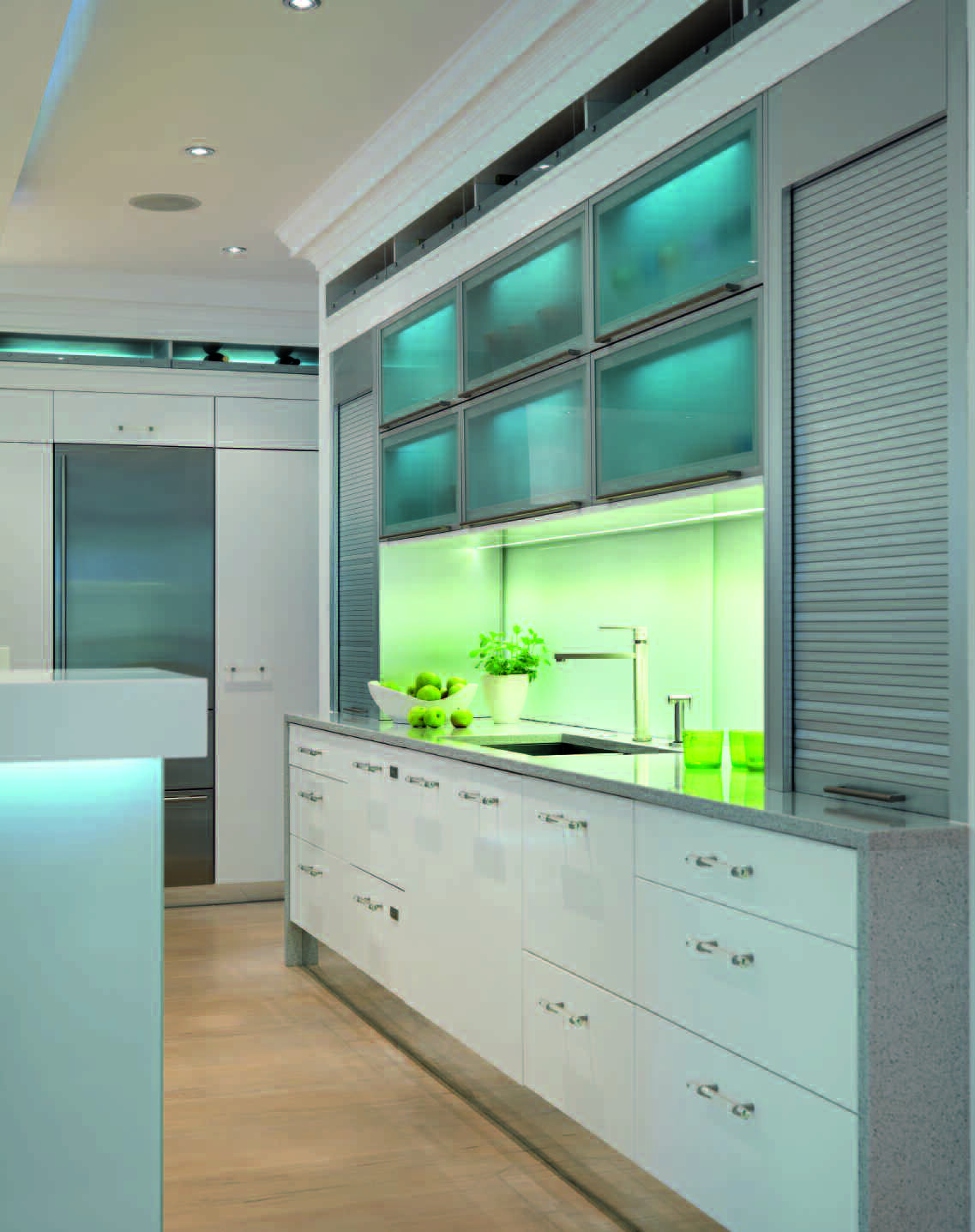 White low cupboard units, illuminated work space. Complementary ...