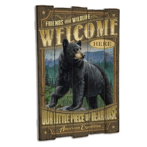 """Wooden Cabin Signs are a great wall decor item for any cabin, lodge, lake home, or den. The illustrations and rustic graphics are printed on real textured wood with varying length slats, giving them a unique vintage sign appeal. Each sign measures 15.25"""" x 23"""" and features a saw-tooth hanger on the backside."""