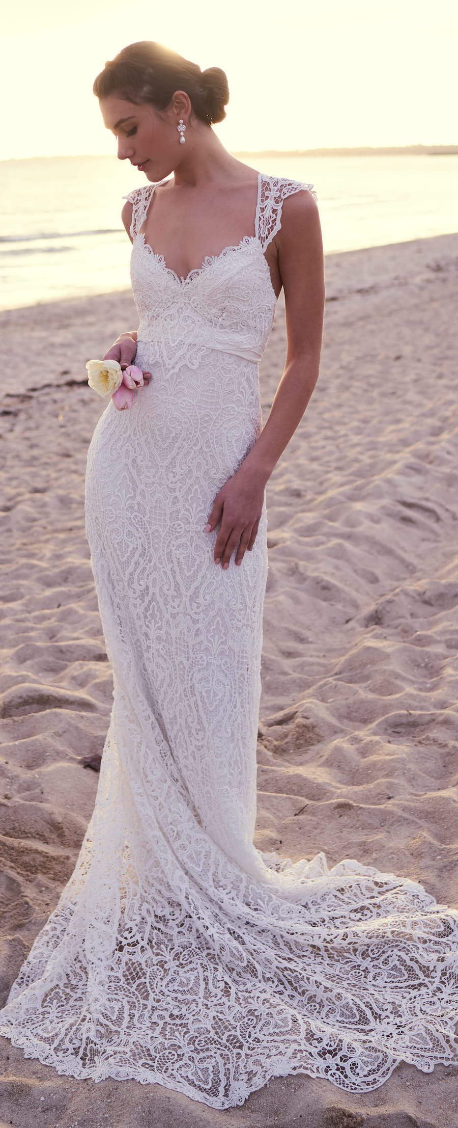 Wedding dress by anna campbell featuring a flattering tbar