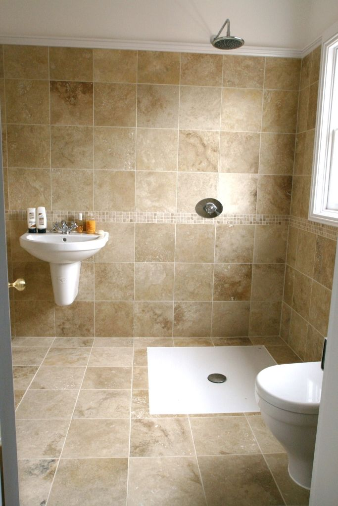 Wet room with tiled walls and floor euro small wet room for Wet floor bathroom designs