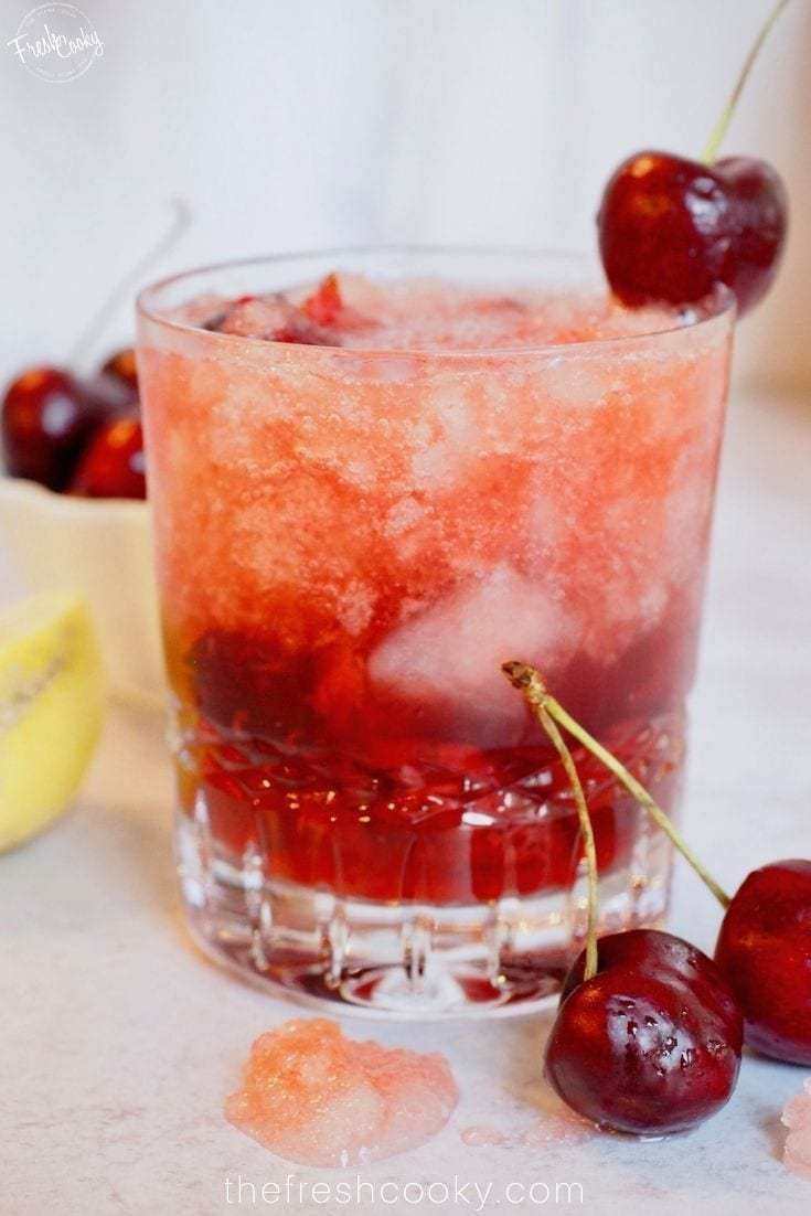 This Cherry Bomb Cocktail recipe is just that, the BOMB! Fresh cherries, maple syrup, vanilla and lemon, topped with a little bubbly club soda. For a delightful end of summer, fall cocktail. Recipe on  |#whiskydrinks