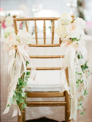 Wedding Chair with Flowers and Ribbons | photography by http://www.ashleyseawellphotography.com