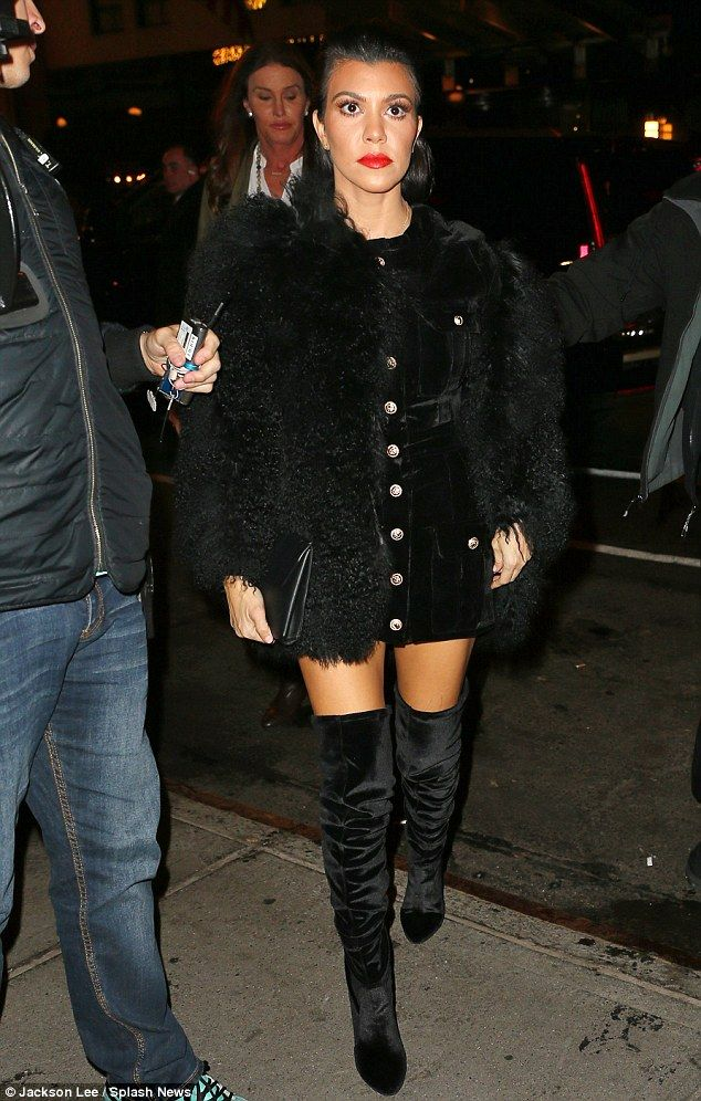 Lovely lady: The 36-year-old no doubt turned heads in her sexy black suede thigh-high booties