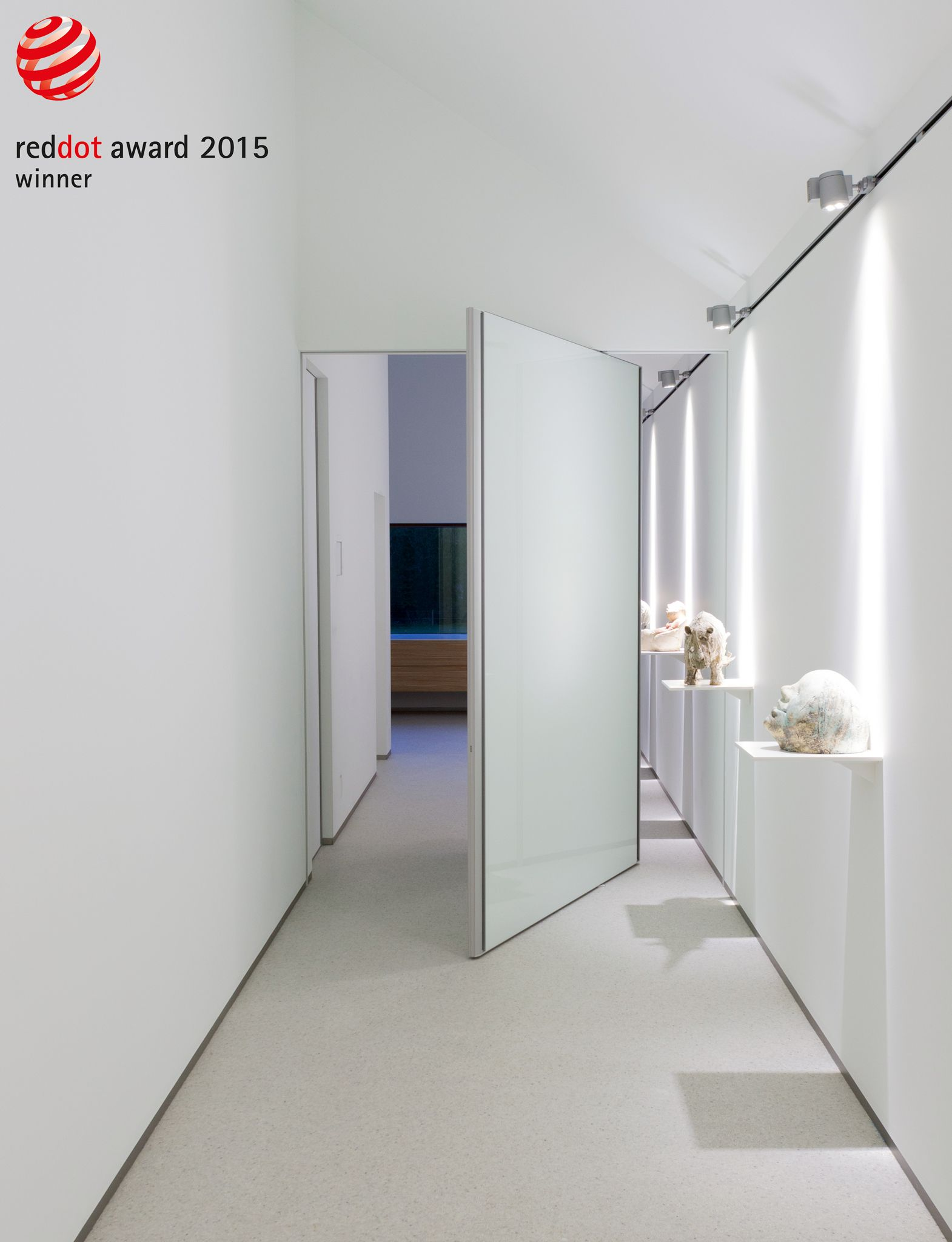White glass pivoting door with an invisible door frame and unique ...