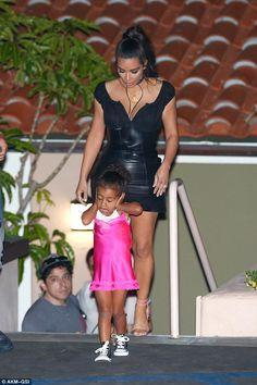 efe81bbf2f Kim Kardashian looks slimmer than ever in plunging leather dress ...