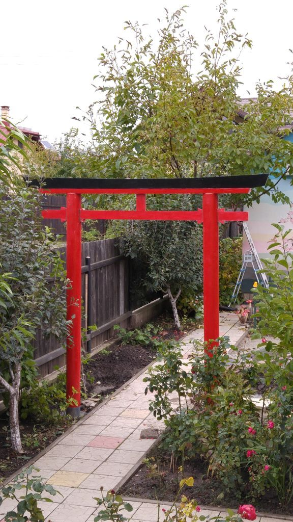 For some time, I had been thinking about building a Japanese torii gate for my garden. A torii gate marks the approach and entrance to a Shinto shrine. It is the division between the physical and spiritual worlds. Shinto is a native religion of Japan and was once its state religion. Probably the most famous torii is the one at Itsukushima Shrine located at Miyajima, near Hiroshima. Mine is a little more modest.