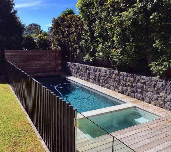 Right Here We Take A Look At 27 Creative Swimming Pool Fencing Concepts For Household Homes Sharing Pool Fence Pool Fencing Landscaping Pool Landscaping
