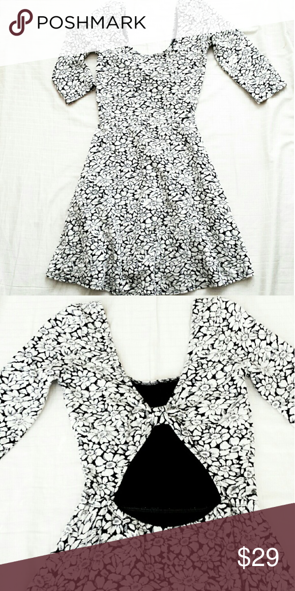 b972828eb8e8 Hollister 3 4 sleeve daisy print skater dress Brand New with no tag.  Exellent condition. Cute cutout and knot on the back. Hits above knee  Hollister Dresses ...