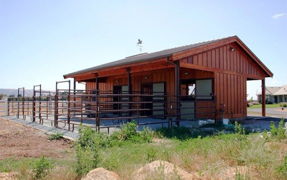 Three stall horse barn with individual runs
