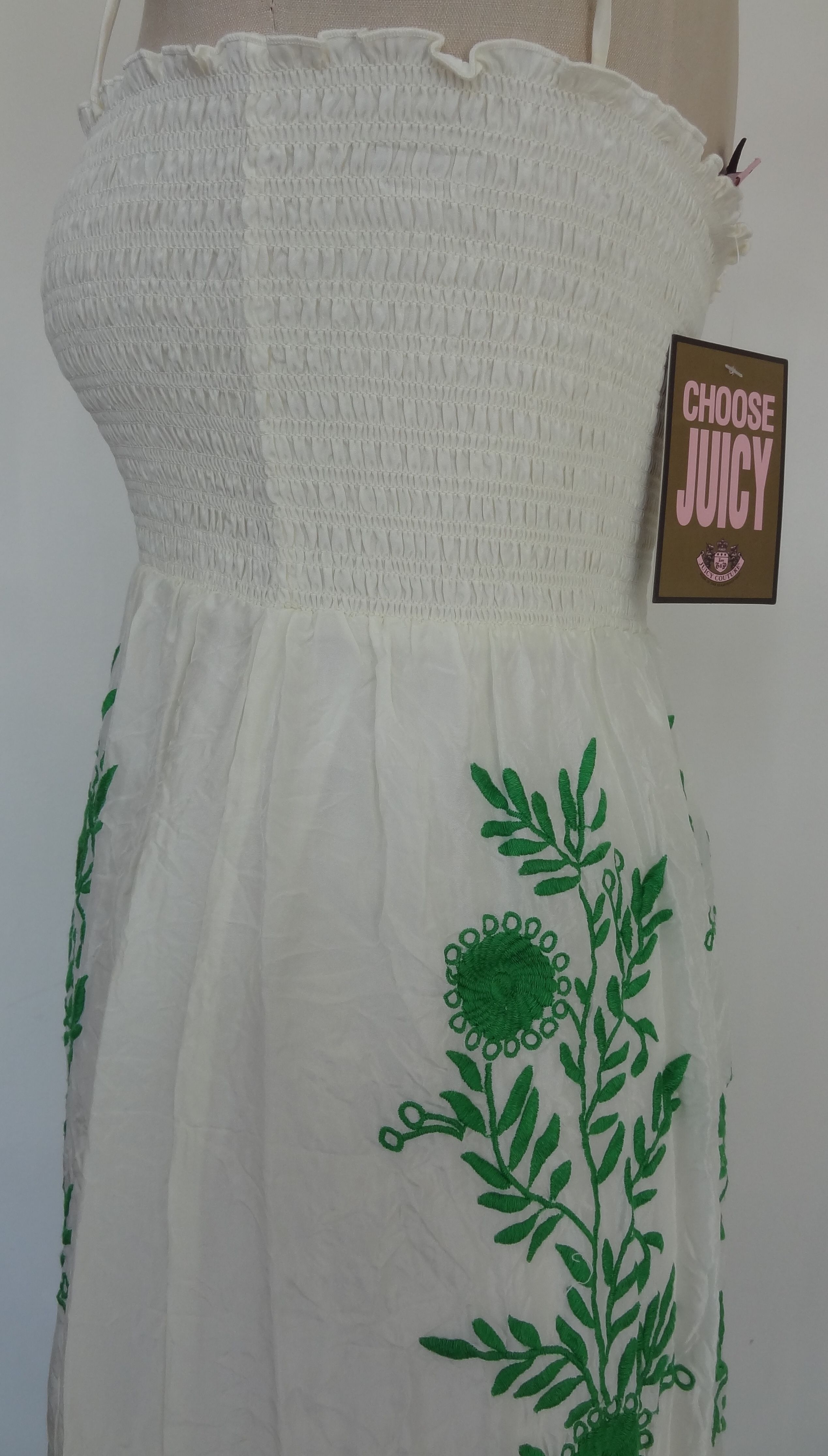 Festival Dress, Juicy Couture Original, designer dresses  One of Juicy Couture's most coveted pieces designed with a hippie inspiration and masterful embroidery   Insanely feminine crushed creamy silk cascades over an underneath skirt slip. Delicate smocked and finely stitched top with stretch for a perfect, stay-put fit. Straight neckline with tasseled self-tie adjustable straps  Exquisite floral and vine embroidery in Green down skirt, front and back. In Angel/Green Style
