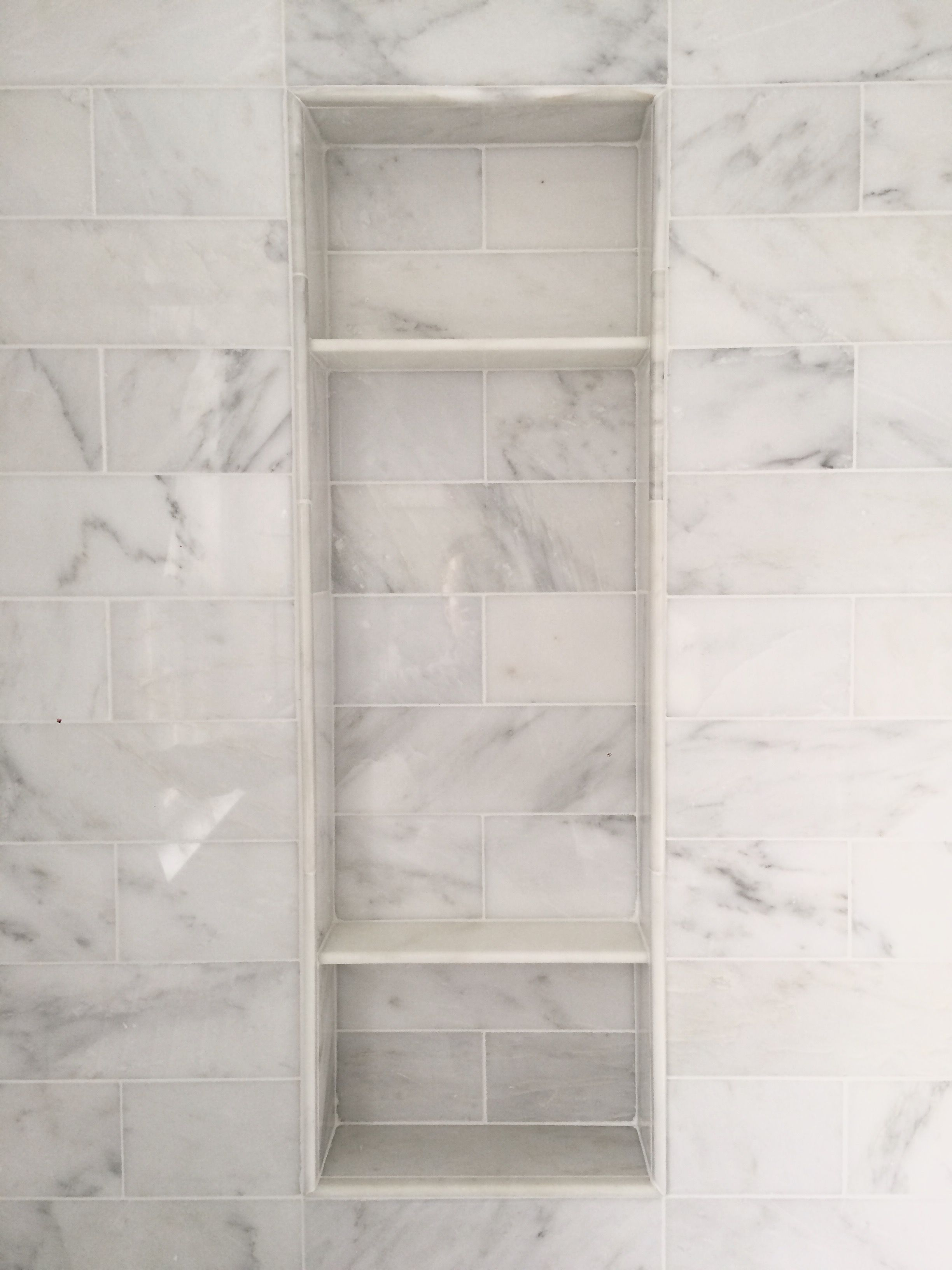 Carrara marble shower niche clean look pinteres for Carrara marble bathroom floor designs