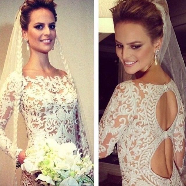 This unique long sleeve wedding gown has two keyhole cut outs no the back.  We can recreate a bridal gown like this for you as shown or with any changes.  We make custom #weddingdresses for brides of all sizes.  Brides can also commission #dariuscordell to make a #replicadress of any dress design they love from the internet.  So if your dream dress is discontinued our out of your price range we can help.  Get pricing and more details at www.DariusCordell.com