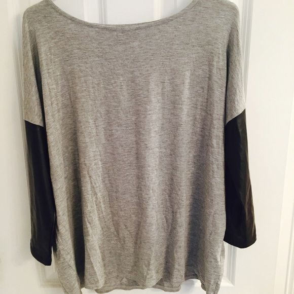 Faux Leather Long Sleeve Three-Quarter length sleeves. Faux black leather arms. Never worn. Forever 21 Tops Tees - Long Sleeve