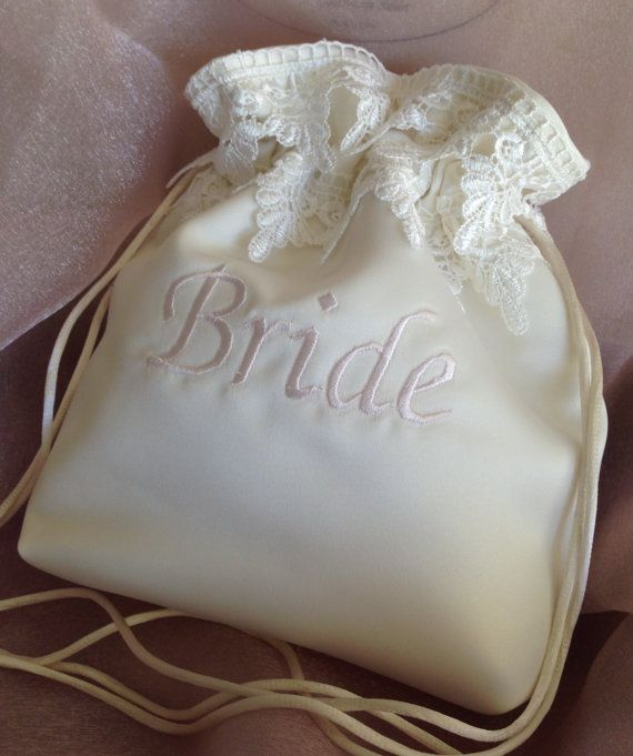 Ivory Embroidered Drawstring Bag With Double Lace On Top Of This