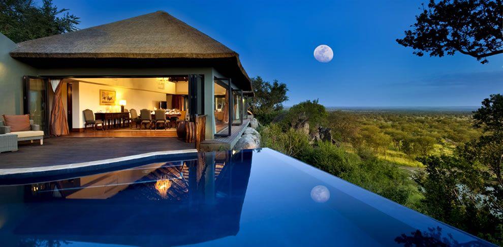 Infinity Pool And Full Moon Overlooking The Serengeti