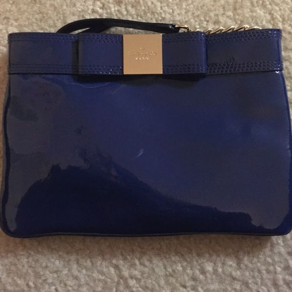 Kate spade primrose hill Arica cross body Blue patent leather with leather and chain strap. Polka dot inside. One zippered pocket and one slide pocket inside. Great condition! No trades please kate spade Bags Crossbody Bags