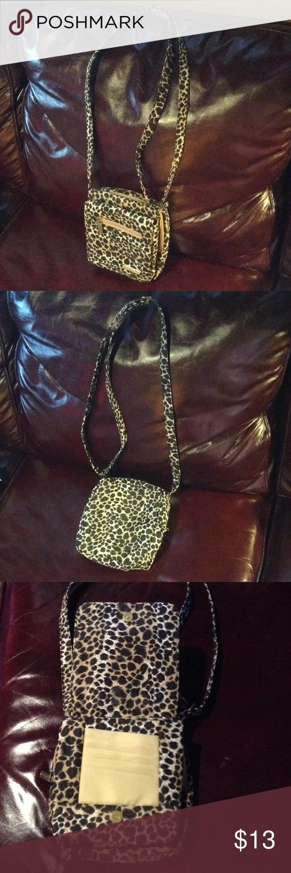 Travelon Brand Patterned Crossbody Bag Travelon brand. Crossbody bag. Adjustable strap. Tan, black, white, brown. Cute. Clean. No issues. Cute bag! Travelon Bags Crossbody Bags