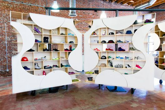 In late 2014, LA sneaker boutique Authentix commissioned Brooklyn based architects UP Studio to design their new outlet. What UP conceptualised was a wholly customisable store, made from five 8-by-8 ft units on wheels able to rotate 360 degrees, allowing constant transformation.