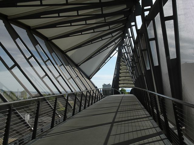 """Amgen bridge by kairuy, via Flickr  """"The bridge is designed to look like a strand of DNA, I think. The slanting screens keep my acrophobia at bay."""""""