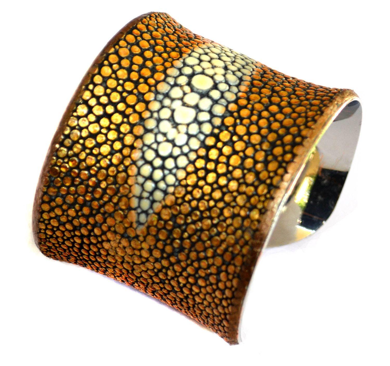Metallic Gold Genuine Stingray Leather Center Cut Cuff Bracelet. $145.00, via Etsy.