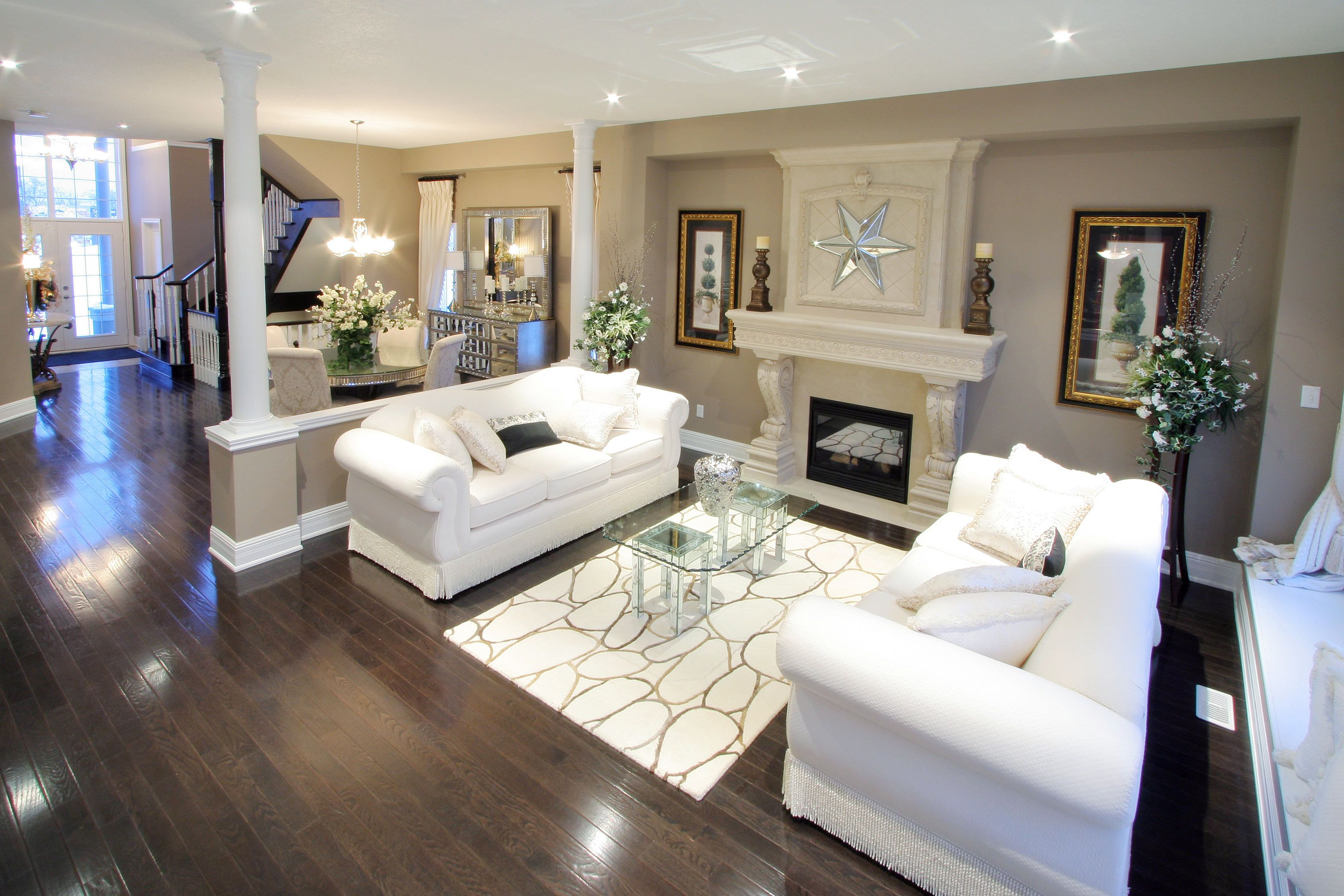 Dark Flooring Contrast Nicely With The Beige Pallet And White