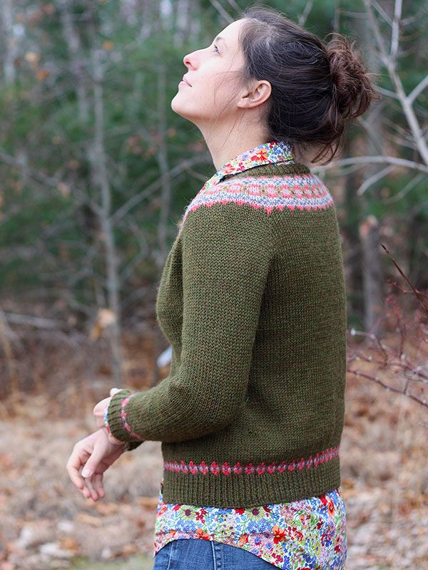 Fair Isle frames the neck, cuffs, and hem of this fabulous top ...
