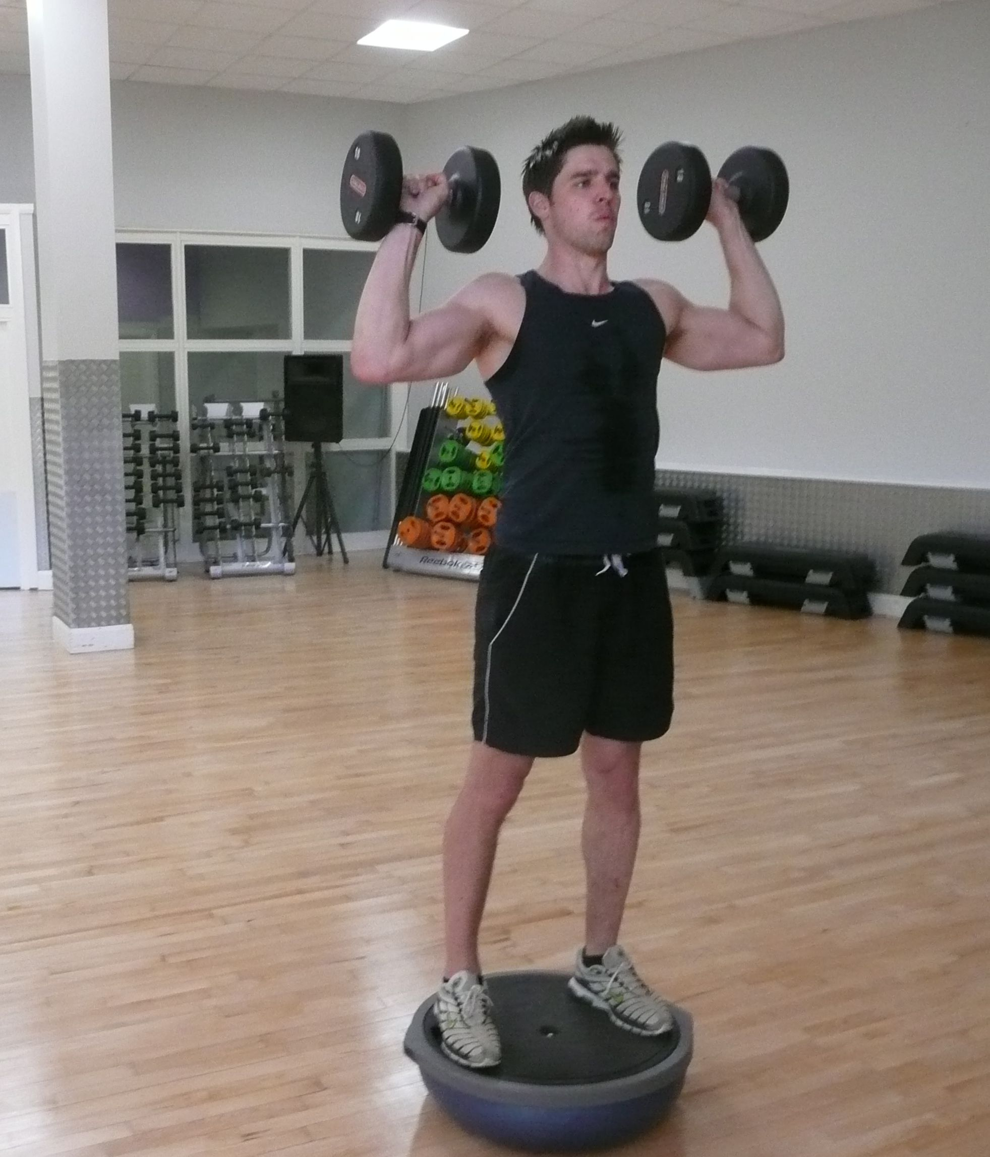 Shoulder Press On Bosu Is Not Safe This Way There S Even A Warning On The Bottom Of The Bosu To Not Use It Upside Down Shoulder Press Style Fashion
