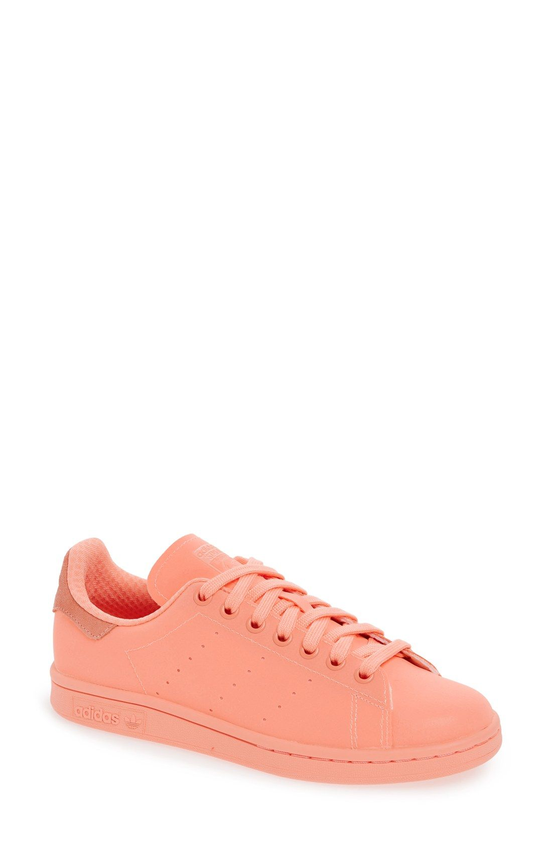 Crushing on this pink Adidas sneaker that add a pop of color to the street wear.