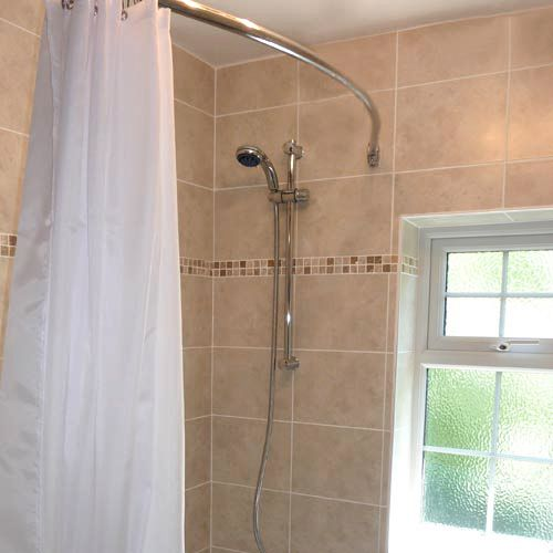 Curved Shower Rail in Stainless steel in this modern bathroom ...